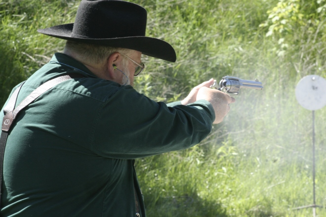 club member participating in cowboy action shooting demonstration