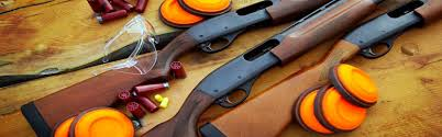 Shotguns, clay pigeons for trap shooting.