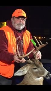 Man showing a deer from a deer hunnt.